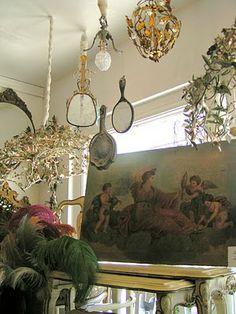 hand mirror chandelier with cherub  painting