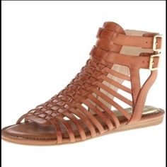 Gladiator sandals by Vince Camuto Brown gladiator sandals by Vince Camuto. Worn twice but in perfect condition. Size 7, TTS. Zippers on the size. Vince Camuto Shoes Sandals