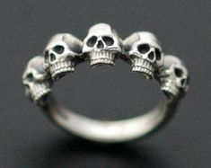 BEAUTY EVEN IN DEATH... This sterling silver and rose gold ring is hand carved from wax, casted in to metal, and finally meticulously refined and polished. Each ring is made to order, please allow a two week production period where your piece is lovingly created and fabricated to perfection. Can be made in all US ring sizes Dont hesitate to contact us with inquiries and special orders. Thanks for looking