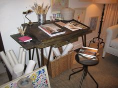 Suzanne Kasler created an artists studio, complete with paint brushes and colorful framed prints.
