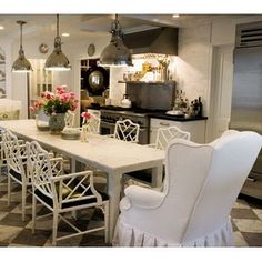 Love wing chairs in the kitchen and love these side chairs in white.