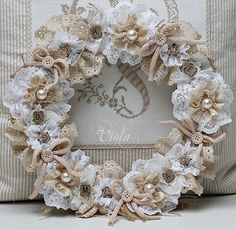Lace wreath mmm looks fun to make one my self with the technique from my flowers make your own pinboard.