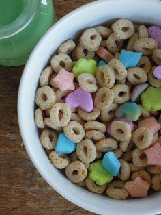 VEGAN LUCKY CHARMS They're magically gluten-free and veganly delicious! 1/2 bag of Dandies vegan marshmallows  1 Tb water  1 1/2 c. powdered sugar  1/2 c. cornstarch  Pink, orange, blue, and green food coloring  fondant mini cutters  Natural Path Whole O's Cereal {it's gluten free AND oh-so yummy!}