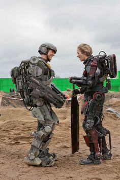 Tom Cruise and Emily Blunt share laughs while on set of their movie Edge of Tomorrow.