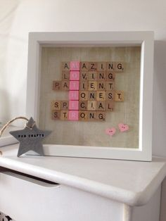 A personal favourite from my Etsy shop https://www.etsy.com/uk/listing/253986133/family-scrabble-frame-scrabble-art