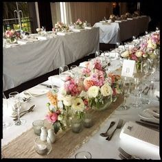 A centre runner of hessian in the table and a mixture of stunning flowers