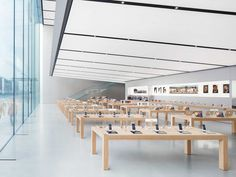"""You'll notice art from Apple's """"Start Something New"""" campaign hanging on the walls. As part of the campaign, Apple is featuring artwork created on iPhones and iPads in stores worldwide."""