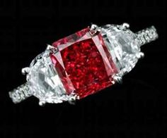 Exceptionally and Extremely Rare Fancy Red diamond ring, 1.92 cts    Claw-set with a modified rectangular-cut fancy red diamond weighing 1.92 carats, flanked by half moon-shaped diamonds, the shank partially set with brilliant-cut stones, mounted in platinum