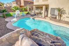 Home for sale Chandler, AZ  4 Bedroom, 3 bath plus office, and huge loft. 3600 sq. ft. Pool with rock waterfall and slide.