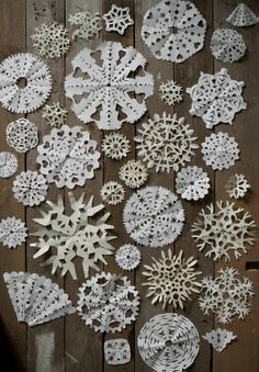 Paper snowflakes - I'd make a variety of snowflakes similar to the ones in this pin. 10$ for at least 12 good size flakes and a few med and smaller ones too!