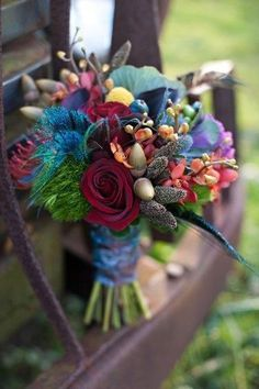 Gorgeous bouquet colors and textures. UH OH FEATHERS!!