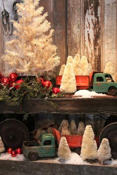 Vintage trucks & bottle brush tree vignette