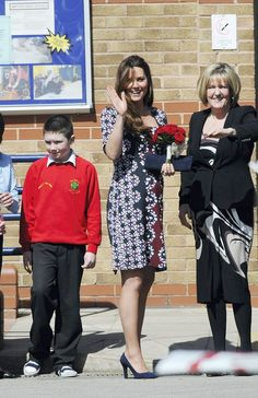 Kate Middleton Catherine Dutchess of Cambridge arriving at the Willows Primary School in Wythenshawe, Manchester for a charity engagement. Kate is showing off her pregnancy bump in a flowing dress