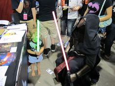 The Brave Little Jedi - This gutsy little girl came out all on her own from her daddy's booth and whacked the sith lord on the head. < - so cute!