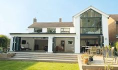 http://www.realhomesmagazine.co.uk/completed-projects/extensions/two-storey-glass-extension