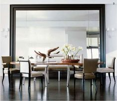 one of my all time favorites...big mirror, mismatched dining chairs, drama... Vincente Wolfe