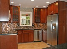 mosaic backplash to complete interesting kitchen cabinet in contemporary house balanced with glossy touches and modern glass door cabinet