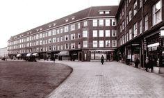 1935 - 1940. View of the Bos en Lommerweg in Amsterdam-West. The Bos en Lommerweg is located in the Bos en Lommer, a diverse neighborhood which has been revitalised in recent years thanks to massive redevelopment. The Bos en Lommer arose during the 1920s and 30s along Admiraal de Ruijterkade and consists mostly of apartment blocks and row housing. It is bordered by Haarlemmerweg, Jan van Galenstraat, the Markthallen and the train line Ringspoorbaan. #amsterdam #1940 #BosenLommerweg