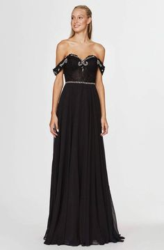 Promote regal flair in this lovely masterpiece flourishing an off-shoulder neckline with draped tapered sleeve and a corset style fitted bodice in sheer lace framed with visible boning and features a classy full-length A-line chiffon skirt. The dress sparkles with Jewel beadings along the neckline, the sleeves and around the natural waist for added glamour. #couturedresses #couturefashion #couturedresses