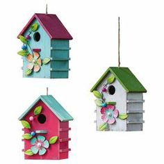 "Invite feathered residents to your garden or backyard with this charming wood birdhouse, featuring a weathered color-block finish and metal floral embellishment.   Product: Set of 3 birdhousesConstruction Material: Wood and metalColor: Pink, blue, green, and gray   Features: Clean up door on back Suitable for year-round use  Dimensions: 14"" H x 8"" W x 2.8"" D"