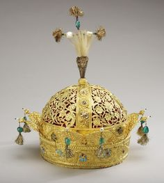 The Crown of Mughal Emperor Bahadur Shah II The crown is made of Gold, turquoises, rubies, diamonds, pearls, emeralds, feathers and velvet.
