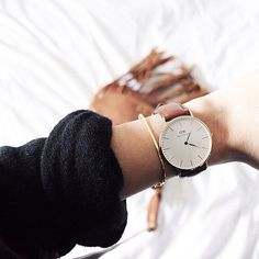 Daniel Wellington wristwatch. a MUSTHAVE!!! I especially love the black and brown leather straps.