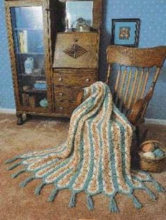 Want to crochet a blanket, but don't feel you have enough time? Try making the World's Fastest Crochet Afghan Pattern. This is one of the quickest and best easy crochet patterns ever. Pretty peach and blue in shell crochet stitch.