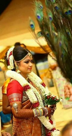Traditional Southern Indian bride wearing bridal saree, jewellery and hairstyle. #BridalMakeup #BridalUpdo