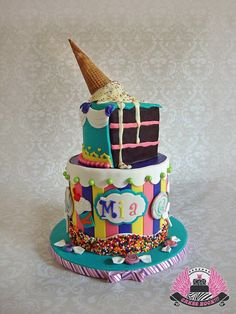 I Want Candy! - Super fun Candy Shop themed birthday cake with matching snow cone cupcakes (see separate picture).  The inside of the bottom tier was a rainbow cake six layers tall.  The ice cream cone is a giant cake pop with a real sugar cone. All edible except the lollipop sticks.
