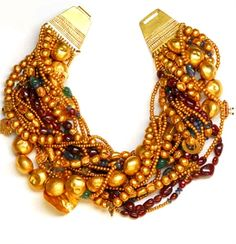 Amrapali multi strand necklace. Consists of Emeralds Rubies Sapphires with old/new gold beads and pendants.