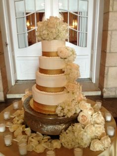 Elegant flowers cascade down this beautiful four tier wedding cake adorned with gold ribbon. www.adinascakery.com Amazing Wedding Cakes, Gold Ribbons, Elegant Flowers, Yummy Cakes, Desserts, Beautiful, Food, Tailgate Desserts, Dessert