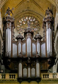 Quintessentially French, the pipe organ in Auch Cathedral, France, was built as early as 1694, and has 4 manuals. The pipes are set in a typical carved wooden case with prominent pedal towers at the sides of the organ case.