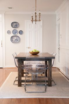 Traditional heavyweight table with modern fragile ghost chairs.
