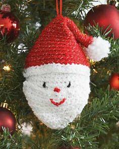 An adorable tree ornament shaped like Santa Claus's head. Shown in Bernat Happy Holidays. (Bernat.com)