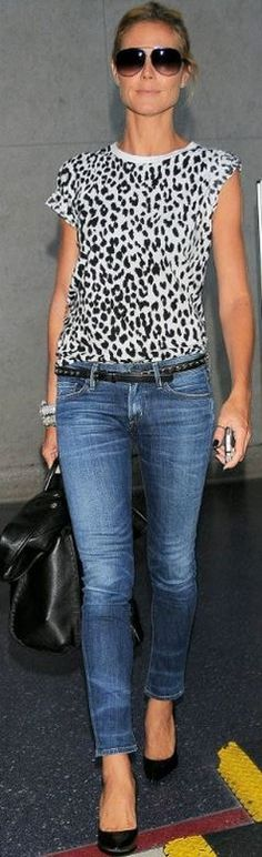 Heidi Klum: Shirt and belt – Saint Laurent  Jeans – Citizens of Humanity  Sunglasses – Dita
