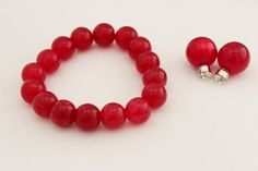 A set of masala red stone beaded bracelet with by SkylaBoutique