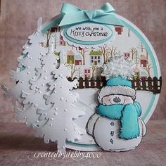 Adorable! Christmas snowman circular card. {I could emboss the snow on the trees by hand; use any snowman; would change background village}