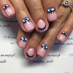 Swooning over this evil eye nail art.