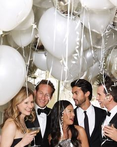 How fun--fill the room with white and silver helium filled balloons for New Year's Eve or any other party!