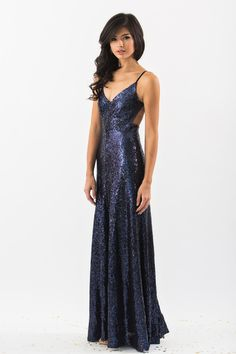 This sequin backless gown is absolutely stunning. The v-neckline and backless cut will have you turning heads all night long. 100% Polyester. Model is wearing a size Small. Measured from a Small: Wais
