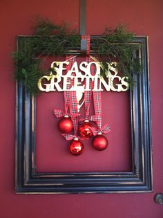"""Christmas frame """"wreath"""" I made for the front door. Had everything on hand except the ribbon so it only cost a couple dollars."""