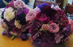 "Purple bouquets. Bridal bouquet (right) with all purples, wines, and violet seasonal flowers including hydrangea and featuring ""Little silvers"" spray roses. Garden Gate Florals-Orlando."