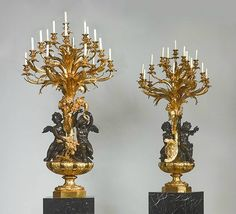 "Louis-Auguste-Alfred Beurdeley, ""War and Peace"". A monumental pair of gilt and patinated bronze allegorical candelabra, Paris, third quarter 19th century."