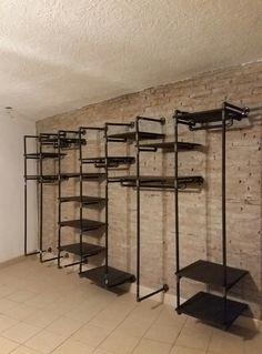 Industrial Pipe Open Closet on Brick Wall by INAC