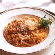 Pumpkin Risotto. Sub Barley for heartier meal. I would sprinkle it on top it with a can-raisin, bacon, pecan mix.