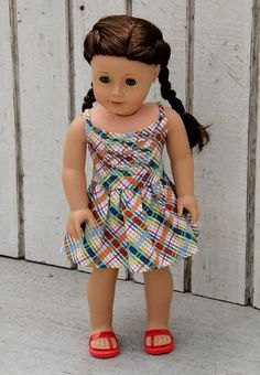 Pleasantly plaid summer sundress by daisychainsdoll. Made with the LJC Boomerit Falls Dress pattern, found here http://www.pixiefaire.com/products/boomerit-falls-dress-18-doll-clothes.  #pixiefaire #libertyjane #boomeritfallsdress