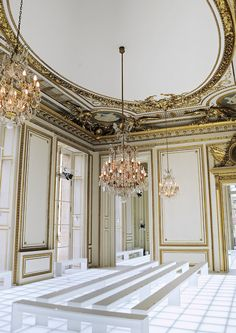 Gold accents  Lit floors  White benches
