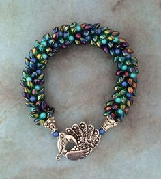 Made to Order Peacock Kumihimo Bracelet by JewelleryByJanine on Etsy https://www.etsy.com/listing/208344830/made-to-order-peacock-kumihimo-bracelet
