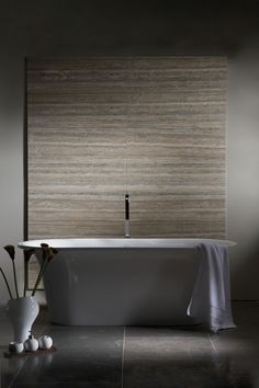 Silver Travertine wall tiles and Blue Romany Limestone floor tiles