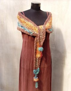Madcap freeform hand croheted and hand knitted scarf  or mini capelet with tufted garnishee. $66.00, via Etsy.
